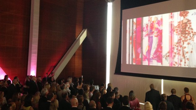 patrons-at-the-clinton-presidential-center-great-hall-watched-a-video-from-oscar-de-la-renta-american-icon-during-the-dedication-of-exhibit-featuring-dresses-from-the-famous-fashion-designer-on-monday-night