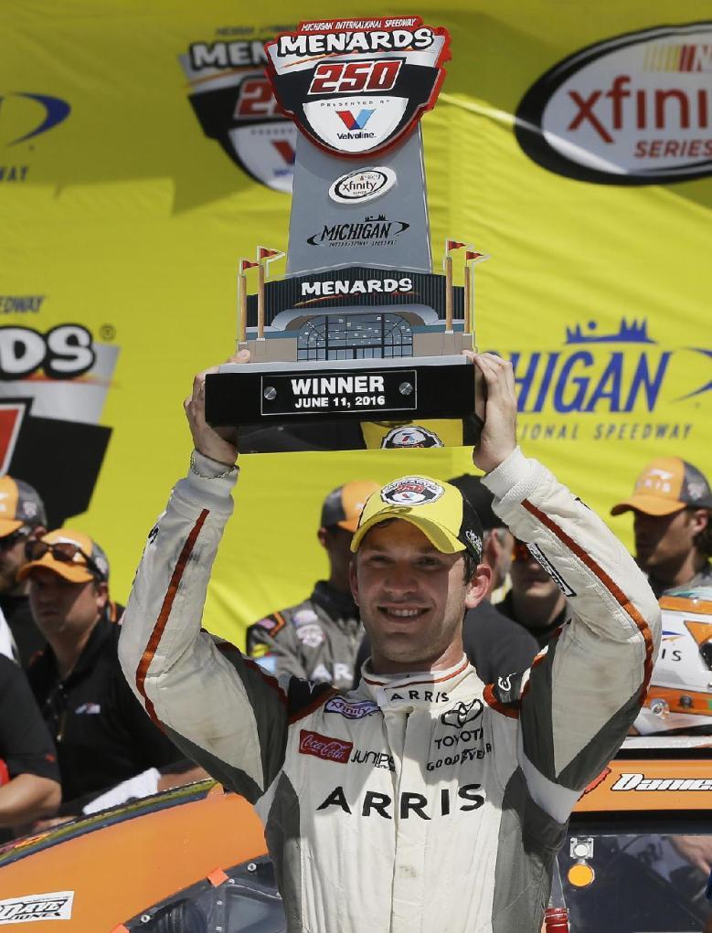 NASCAR Xfinity Series driver Daniel Suarez celebrates after winning the ...