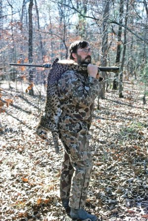 Jim Spencer of Calico Rock is shown with a bobcat he killed in Saline County. Hunting these big cats can be a very challenging endeavor.