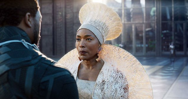 "For Ramonda's (Angela Bassett) hat and ""shoulder mantle"" in her Black Panther opening scene with T'Challa/Black Panther (Chadwick Boseman), costume designer Ruth E. Carter made use of a 3-D printer in Belgium."