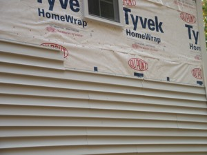 This vinyl siding job could be done better. When water gets behind the siding, it will leak into the house and cause wood rot. PHOTO CREDIT: Tim Carter
