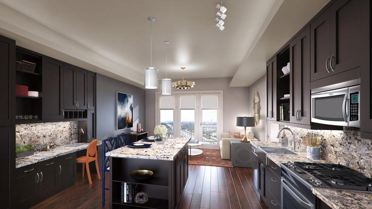 A renter living in one of Houston's luxury apartments can expect to pay nearly $600 more per month than a renter living in a non-luxury apartment, according to a new report from RentCafe. Pictured is a rendering of a unit and kitchen in The Carter, a luxury apartment building under construction.