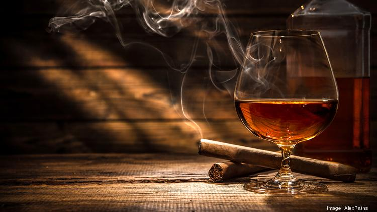 This upscale whiskey and cigar bar is the first venture The Menagerie Hospitality Group.