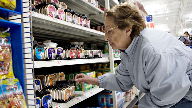 A woman shops inside a Wal-Mart grocery section in this 2009 file photo.