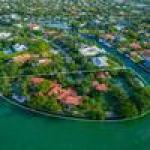 Home swap: Fisher Island condo traded for Key Biscayne mansion