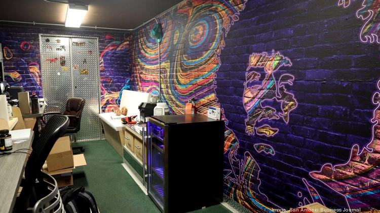 Art work is painted on the walls at Cruising Kitchens allowing their employees to create ideas.