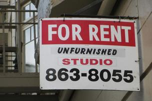 for rent apartment studio sign