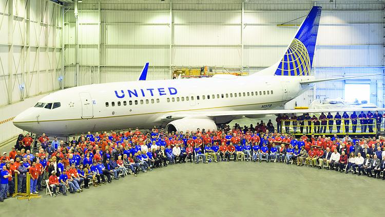 In this 2014 photo, hundreds of North State Aviation workers gather in front of a United Airlines plane at the company's Smith Reynolds Airport facility in Winston-Salem. Many of North State Aviation's employees previously worked at Piedmont Airlines, a once dominant air carrier. The company notified that the state that it would lay off 345 employees.