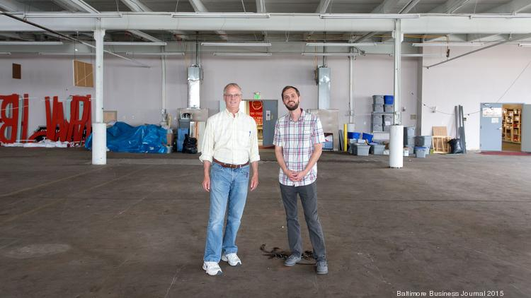 BARCO Director Laurens 'Mac' MacLure, left, and Project Coordinator Will Holman at the site of a new incubator in the works at the intersection of Greenmount Avenue and Oliver Street in Station North.