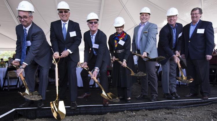 Officials break a little ceremonial ground on Wednesday in Menlo Park for Menlo Gateway, the long-planned office and hotel complex. From left to right are Matthew Stevens, CEO of Bay Club; Kambiz Babaoff, managing director of Ensemble Real Estate Investments; David D. Bohannon II, SVP of Bohannon Development Co.; Rose Bickerstaff, Belle Haven community leader; Menlo Park Mayor Rich Cline; Scott Bohannon, SVP of Bohannon Development Co.; and Robert Webster, president and CEO of Bohannon Development Co.