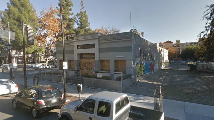 The shuttered McDonald's in downtown San Jose has been boarded up for months.