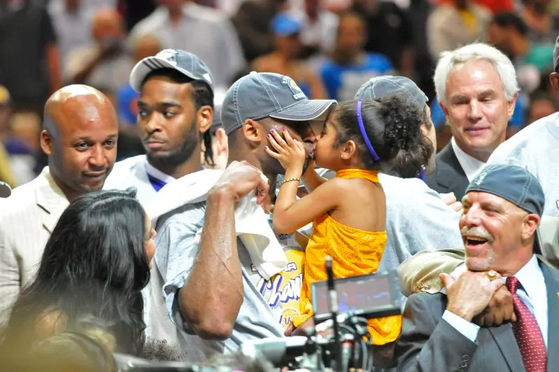ORLANDO, FL - JUNE 14: Kobe Bryant #24 of the Los Angeles Lakers kisses his daughter Gianna Bryant as they celebrate the Lakers winning the 2009 NBA Finals against the Orlando Magic in Game Five of the 2009 NBA Finals at Amway Arena on June 14, 2009 in Or