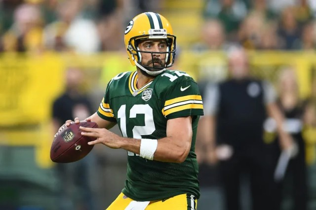 GREEN BAY, WI - AUGUST 16:  Aaron Rodgers #12 of the Green Bay Packers drops back to pass during a preseason game against the Pittsburgh Steelers at Lambeau Field on August 16, 2018 in Green Bay, Wisconsin.  The Packers defeated the Steelers 51-34.  (Photo by Stacy Revere/Getty Images)