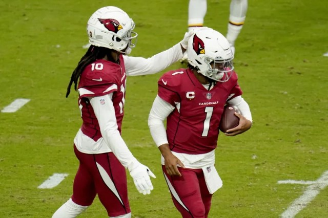 Arizona Cardinals quarterback Kyler Murray (1) celebrates his touchdown run with wide receiver DeAndre Hopkins (10) during the first half of an NFL football game against the Washington Football Team, Sunday, Sept. 20, 2020, in Glendale, Ariz. (AP Photo/Ross D. Franklin)