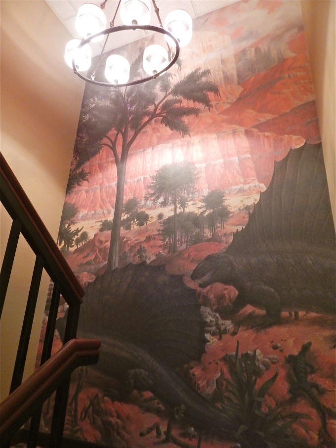 An exclusive inside look at denver s dinosaur hotel for Age of reptiles mural