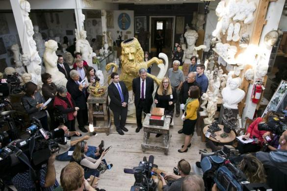 Representatives from the Bostonian Society talk to the media after opening a 113-year-old time capsule, which was found inside a lion statue, at Skylight Studios in Woburn, Massachusetts, October 9, 2014. [Reuters]