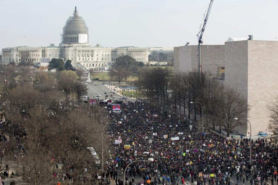Demonstrators rally on Pennsylvania Avenue.  REUTERS/Joshua Roberts