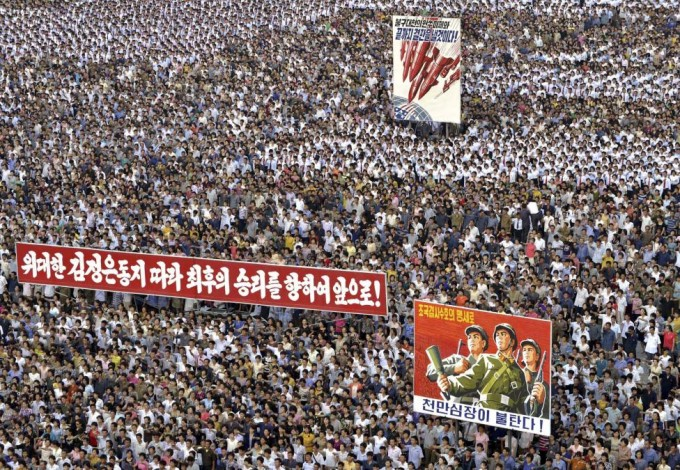 "People attend a mass rally against ""U.S. Imperialists"" at Kim Il Sung Square in Pyongyang in this undated photo released June 25, 2014. REUTERS/KCNA"