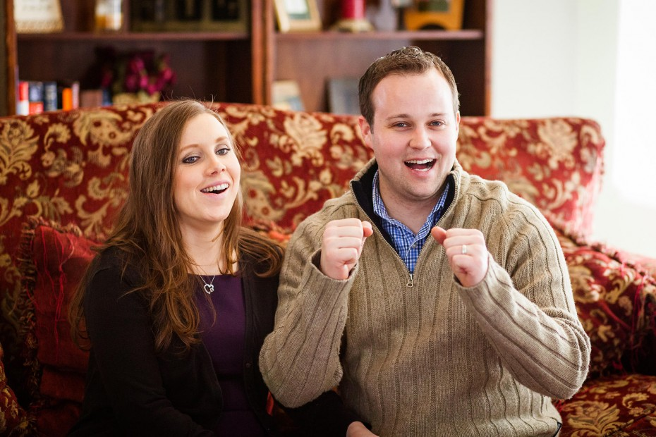 "In a TLC publicity still from ""19 Kids and Counting,"" Josh Duggar and his wife react to news that their due baby will be a girl."