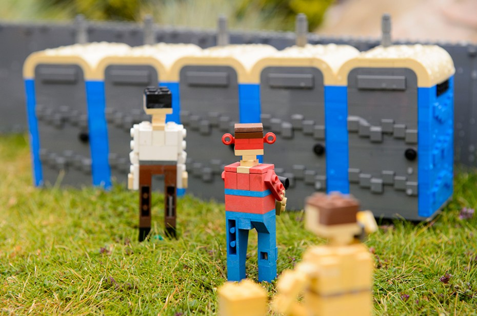 The recreation features tiny toilets, tents and festival-goers mud-sliding in real Glastonbury Festival mud delivered direct to Legoland from Worthy Farm.
