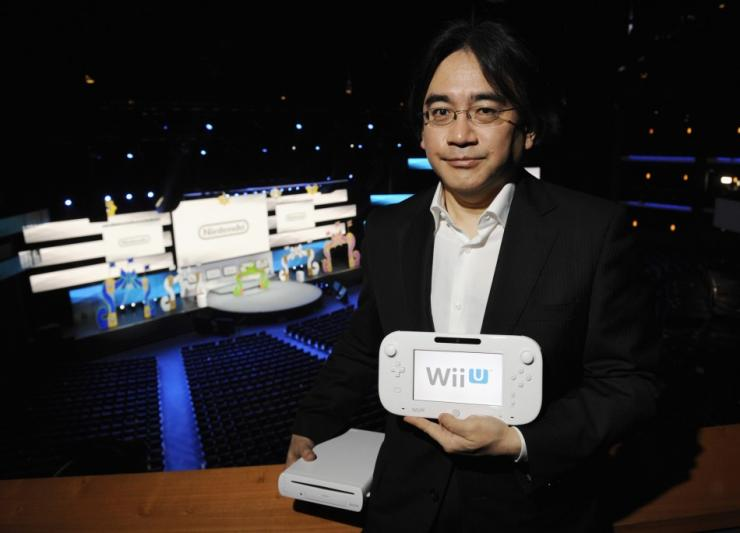 279802-nintendo-president-with-the-wii-u-gamepad