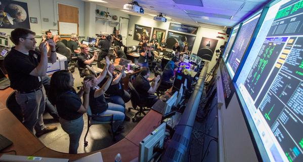 The New Horizons team at work, after a successful Pluto encounter. Photos: NASA