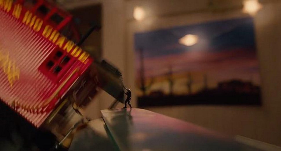Fig. 3: Ant-Man throwing a toy train.