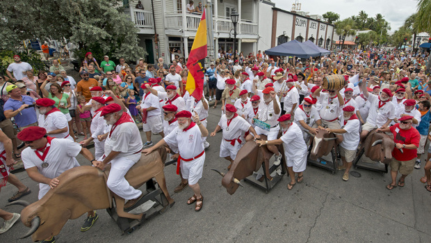 "Ernest Hemingway Look-Alikes kick off the annual ""Running of the Bulls"" Saturday, July 25, 2015, in Key West, Fla. The whimsical and much safer answer to the event's namesake in Pamplona, Spain, was staged as a facet of the island city's annual Hemingway Days festival that ends Sunday, July 26. Hemingway lived and wrote in Key West throughout the 1930s. FOR EDITORIAL USE ONLY (Andy Newman/Florida Keys News Bureau/HO)"
