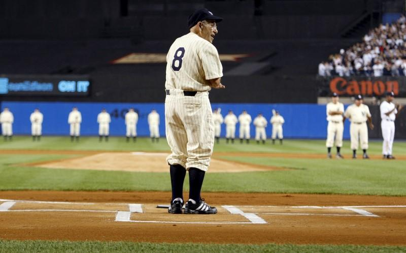 Yogi Berra stands at home plate, 2008. REUTERS