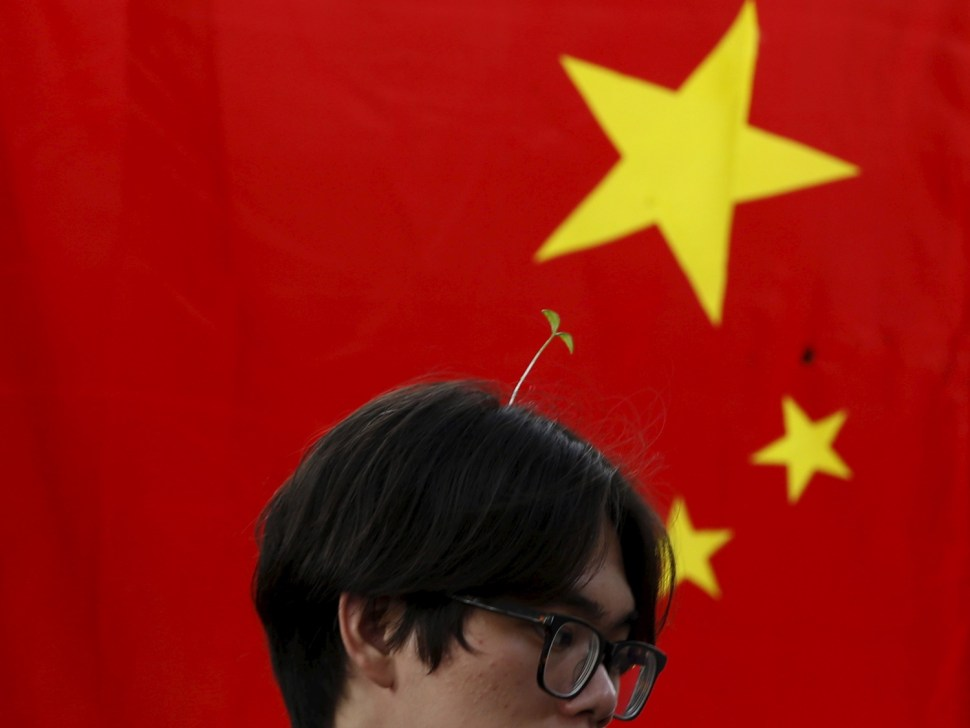 A sprout-sporting guy in Beijing. REUTERS