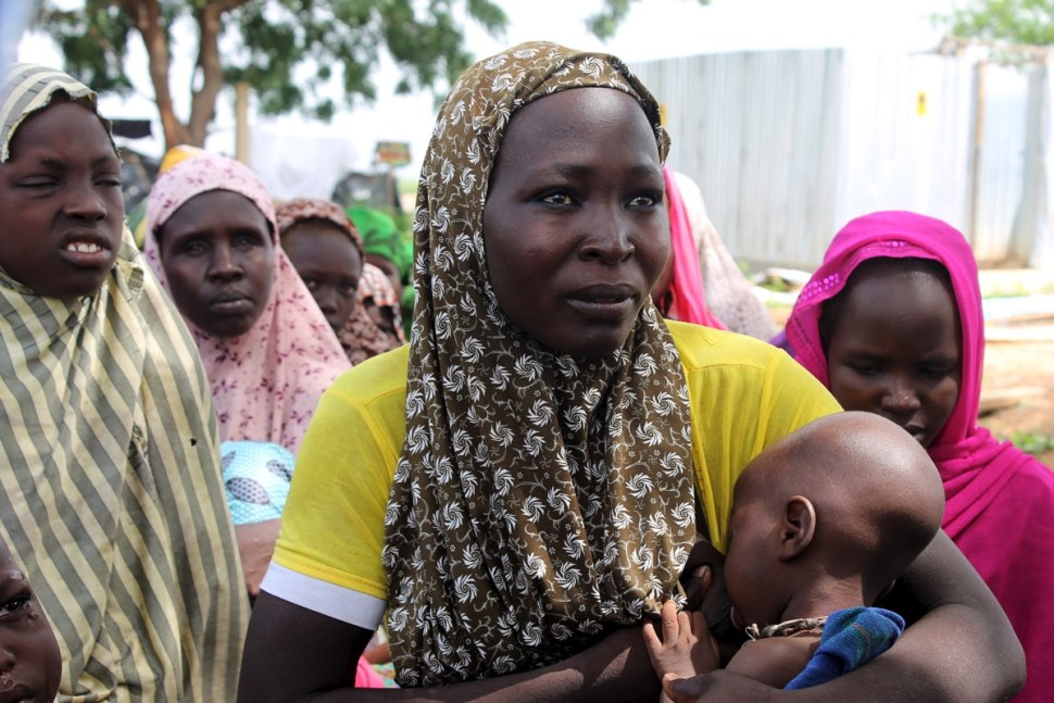 A woman breastfeeds her baby after being rescued from Boko Haram, near Mubi, northeast Nigeria. Oct. 29, 2015. REUTERS