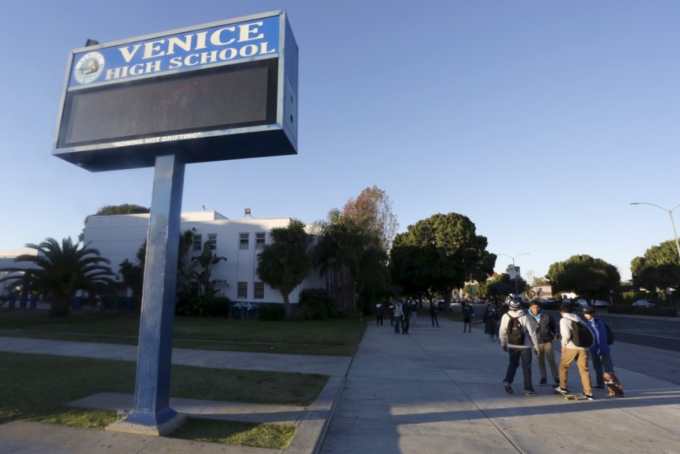 Students stand out front of Venice High School in Los Angeles, California Dec. 15, 2015. REUTERS/Jonathan Alcorn