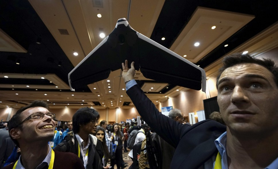 Representatives from the French company Parrot demonstrate a prototype of their new Disco drone at the opening event at CES 2016. The Disco is the first wing-shaped drone which a user can pilot with no learning process, according to the company. REUTERS