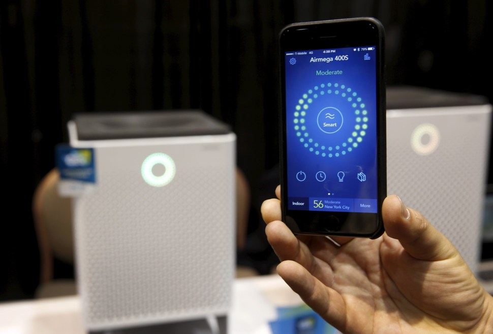 A smartphone receives real-time information on air quality from an Airmega air purifier from Coway. The WiFi-enabled, smart air purifiers from South Korea range in price from $749.00-$849.00 depending on the size. REUTERS