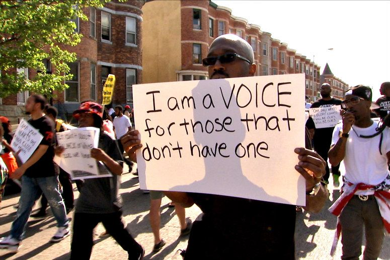 An activist marches during the Black Lives Matter episode of 'Truth and Power.'