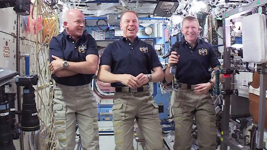 Expedition 47 astronauts (L-R) Jeff Williams, Tim Kopra and Tim Peake share a light moment with reporters on Earth. NASA TV