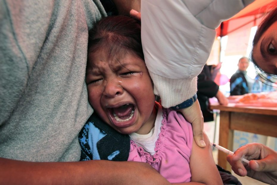A child reacts while receiving a vaccination against measles and rubella in La Paz, Bolivia. REUTERS