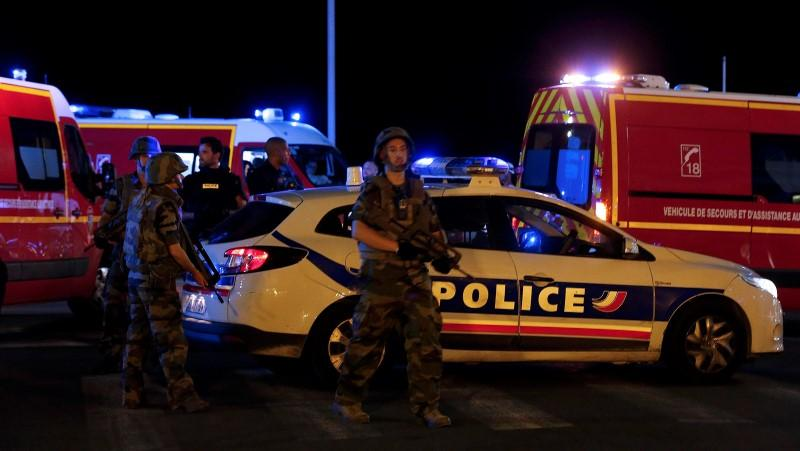 French soldiers and rescue forces are seen at the scene whare at least 30 people were killed in Nice, France, when a truck ran into a crowd celebrating the Bastille Day national holiday July 14, 2016.  REUTERS/Eric Gaillard