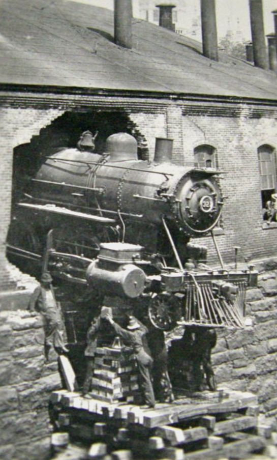 Image result for early paris train breaking through a building