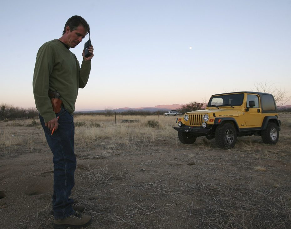 Chris Simcox, then president of the Minuteman Civil Defense Corps, listens to a volunteer's radio transmission on the scout line 23 miles north of the U.S. and Mexican border in the Avra Valley during the organization's month long muster near Three Points, Arizona, March 31, 2007. REUTERS