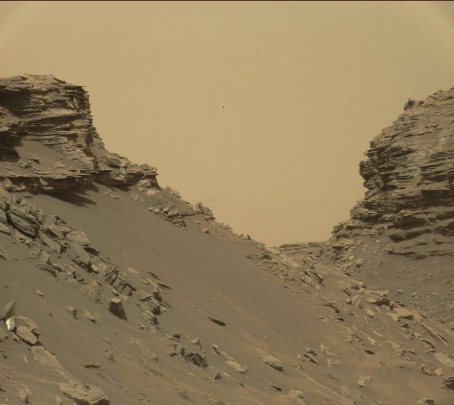 "This view from the Mast Camera (Mastcam) in NASA's Curiosity Mars rover shows sloping buttes and layered outcrops within the ""Murray Buttes"" region on lower Mount Sharp."