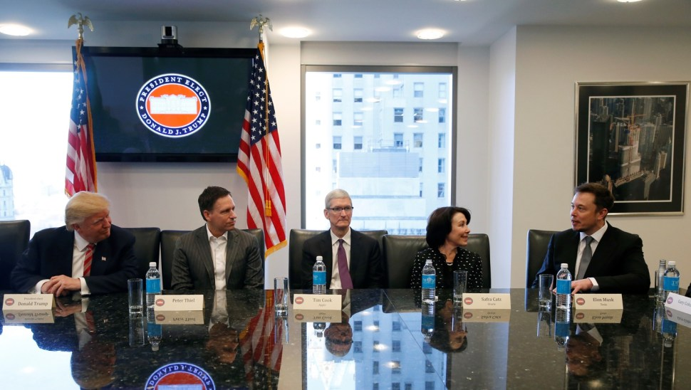 U.S. President-elect Donald Trump sits with PayPal co-founder and Facebook board member Peter Thiel, Apple Inc CEO Tim Cook, Oracle CEO Safra Catz and Tesla Chief Executive Elon Musk during a meeting with technology leaders at Trump Tower in New York U.S., December 14, 2016.