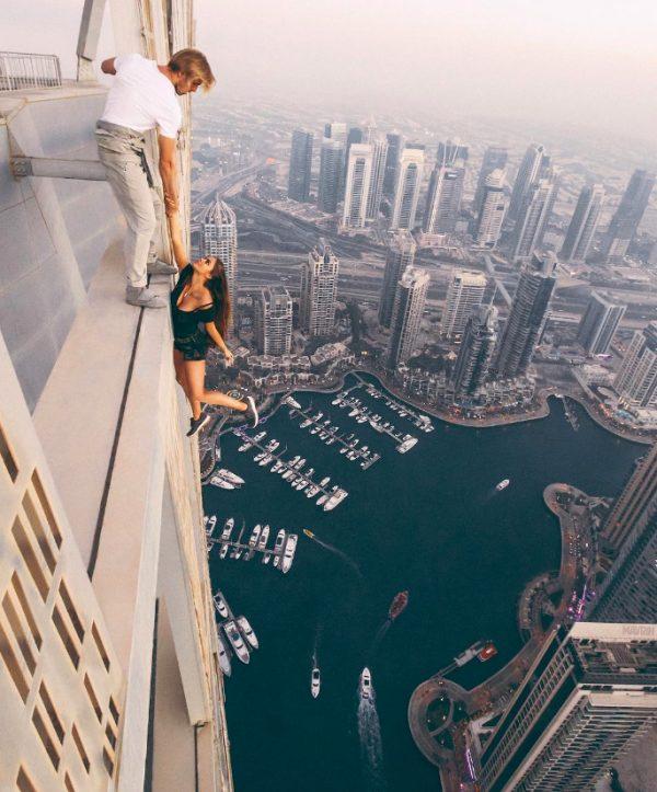 Watch a model dangle off a skyscraper for a photo shoot