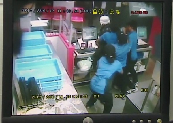 Watch: Domino's Pizza employees tackle and rough up an armed robber