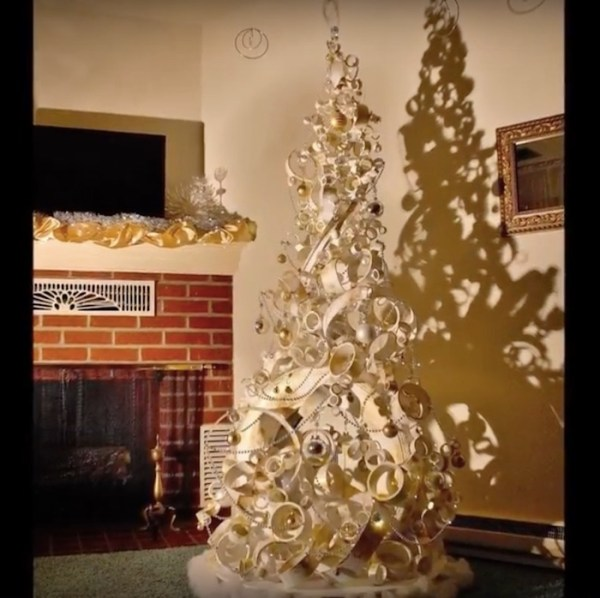 Watch how a couple makes a Christmas tree with a tire, a plastic bucket, and a PVC pipe