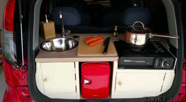 Man builds full kitchen in back of tiny electric car