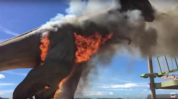 Life-size animatronic T-Rex bursts into flames at dinosaur theme park