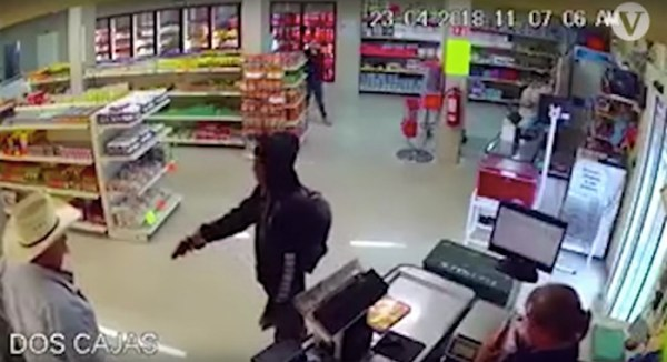 Man in the big straw hat takes down gunman