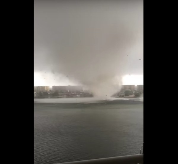 Watch: Water spout surprises couple when it turns into a tornado
