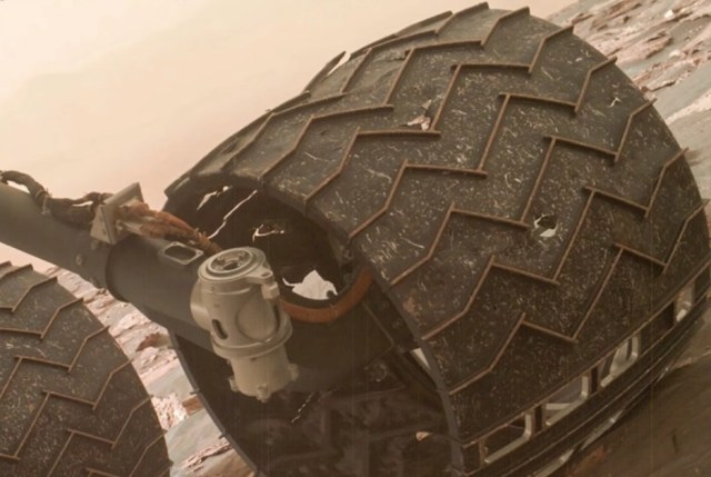 The Mars Curiosity Rover's wheels are as thin as credit cards